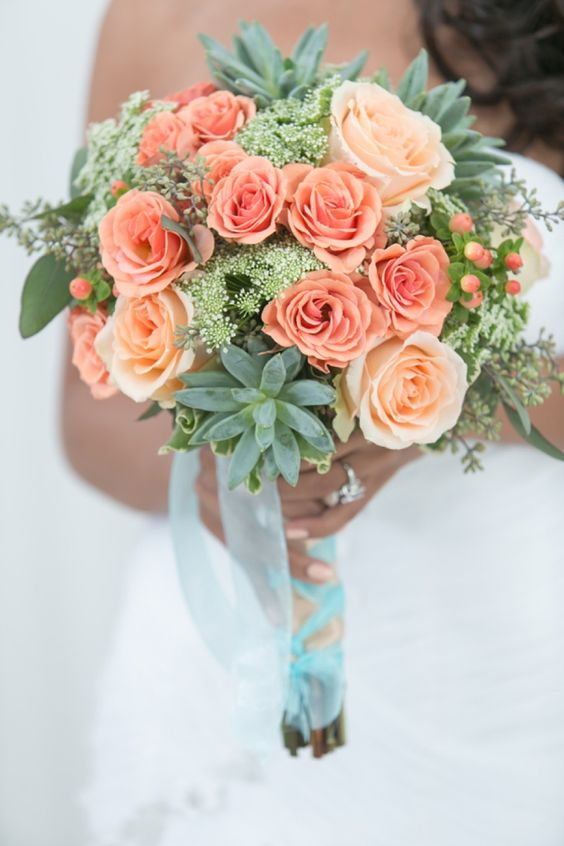 peach colored roses look fresh and subtle with mint colored succulents