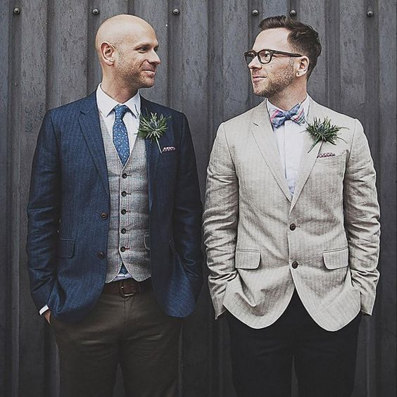 a striped navy jacket, a grey vest, a blue tie and an ivory striped jacket with a bold bow tie
