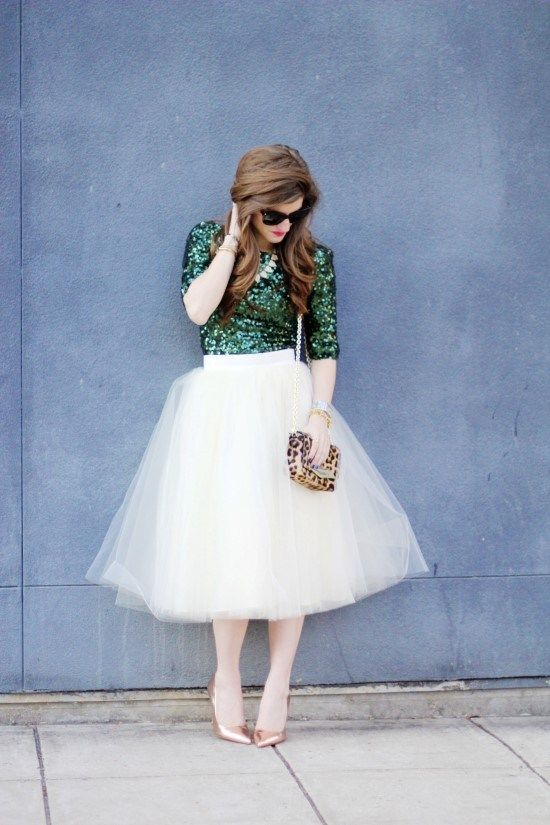 an emerald sequin top, a white tulle skirt and metallic shoes
