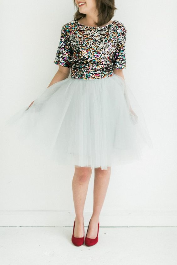 colorful sequin top, a white tulle skirt and red shoes
