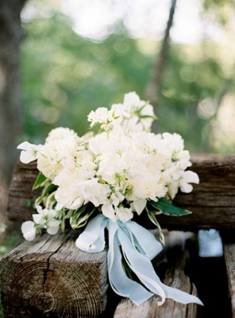 lush white bouquet with silk blue ribbon