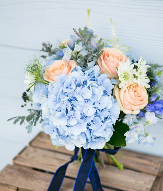 peach and light blue hydrangeas wedding bouquet