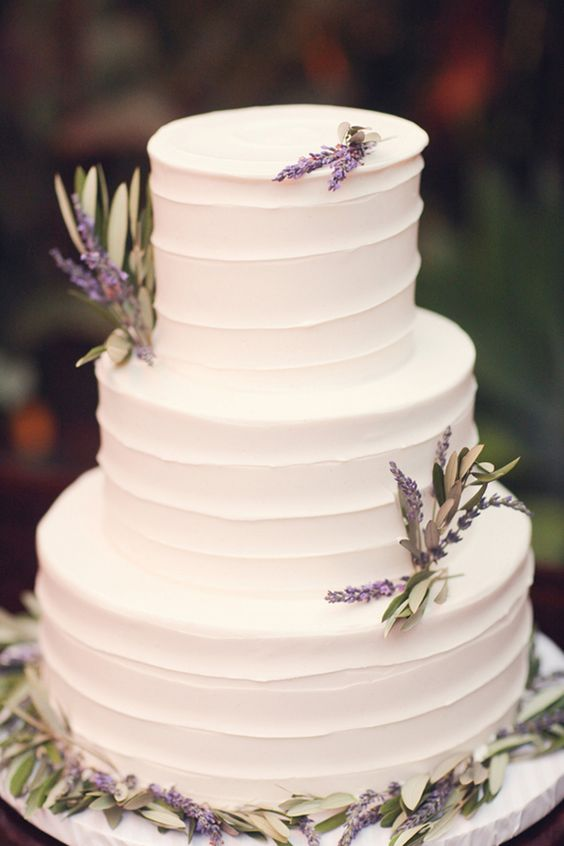 White Frosted Wedding Cake With Lavender Sprigs