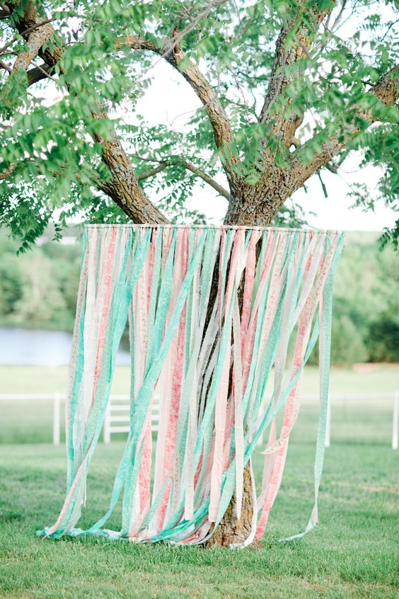 ribbon photo booth backdrop in ivory, peach and mint