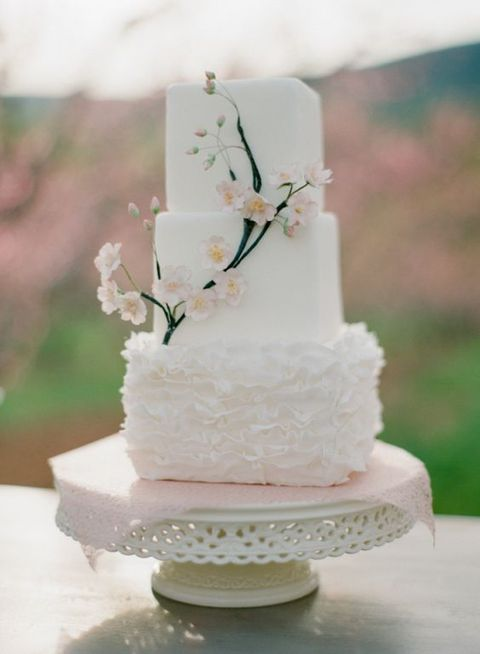 square white wedding cake with decorative blooms