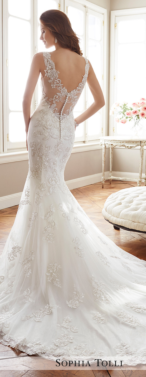 lace wedding dress with an illusion back, a V cut and buttons