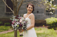 02 The bride was wearing a white dress with a loose skirt, a beaded top, wide straps and a dramatic moody bouquet