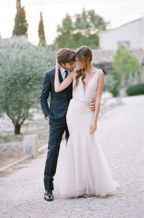 a plunging neckline wedding gown with a glitter sash
