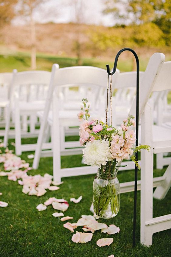 blush and ivory flowers for decorating the aisle and petals