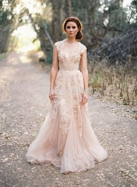 boho lace blush wedidng dress with a deep V-neck
