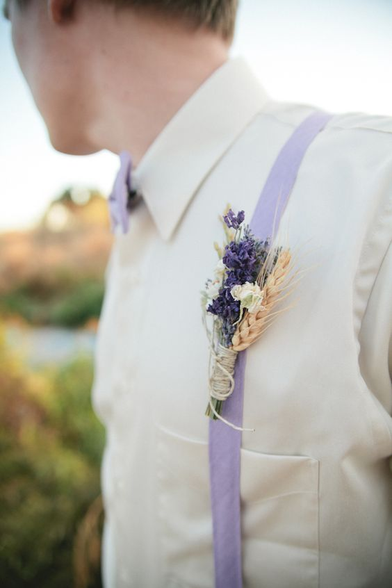 ivory shirt, lilac-colored bow tie and suspendaers and a lavender and wheat boutonniere