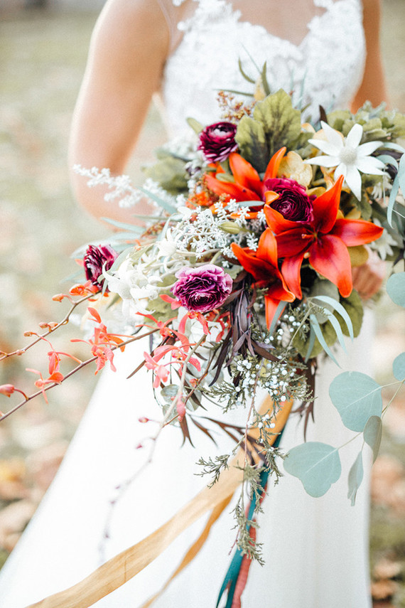 look at the whimsy cascading bridal bouquet, it's all about herbs, leaves and fall tones