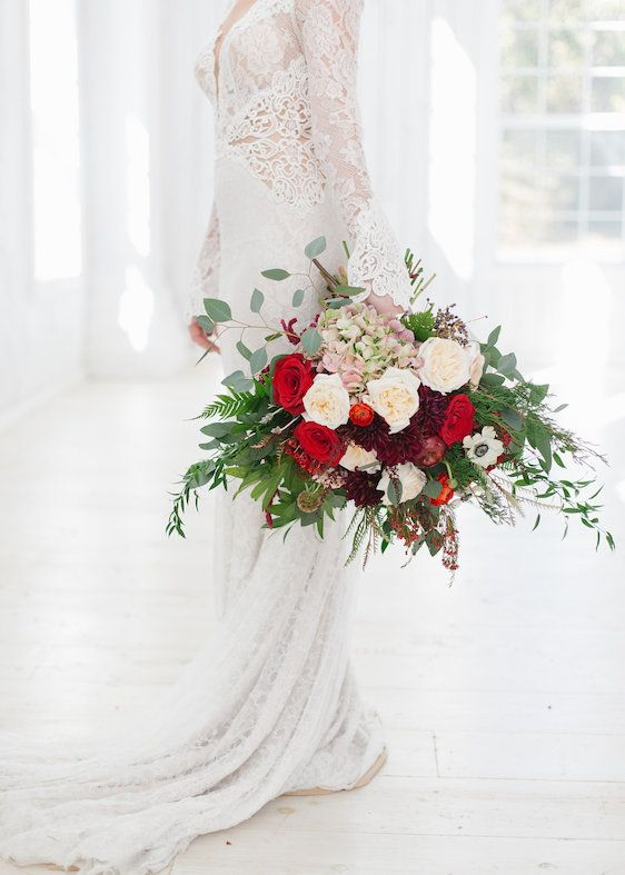 stuning dimensional wedding bouquet with touches of red