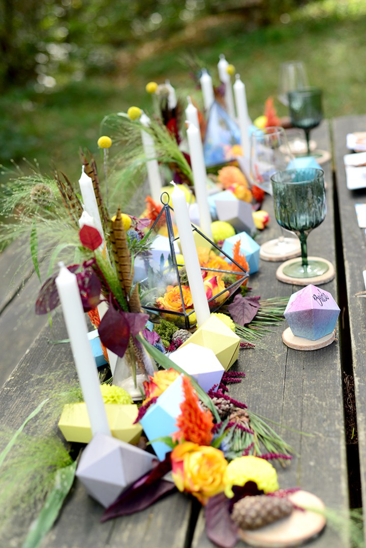 Geometric shapes, bold flowers, feathers table runner brought a Navajo touch to the wedding
