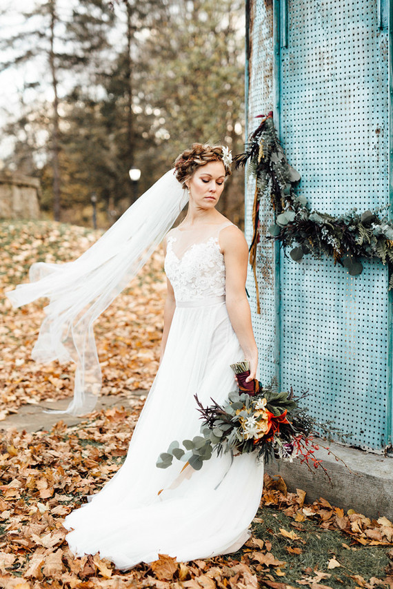Her look was with an illusion neckline wedding dress and a braided updo with a veil