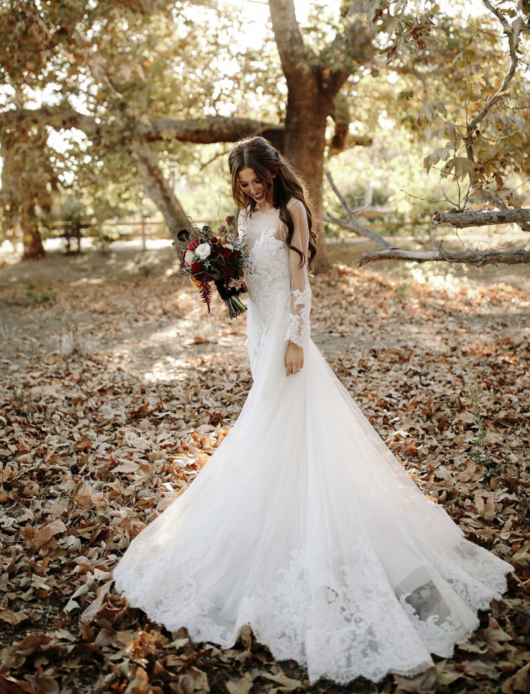 The bride was wearing a unique vintage-inspired lace gown with long sleeves