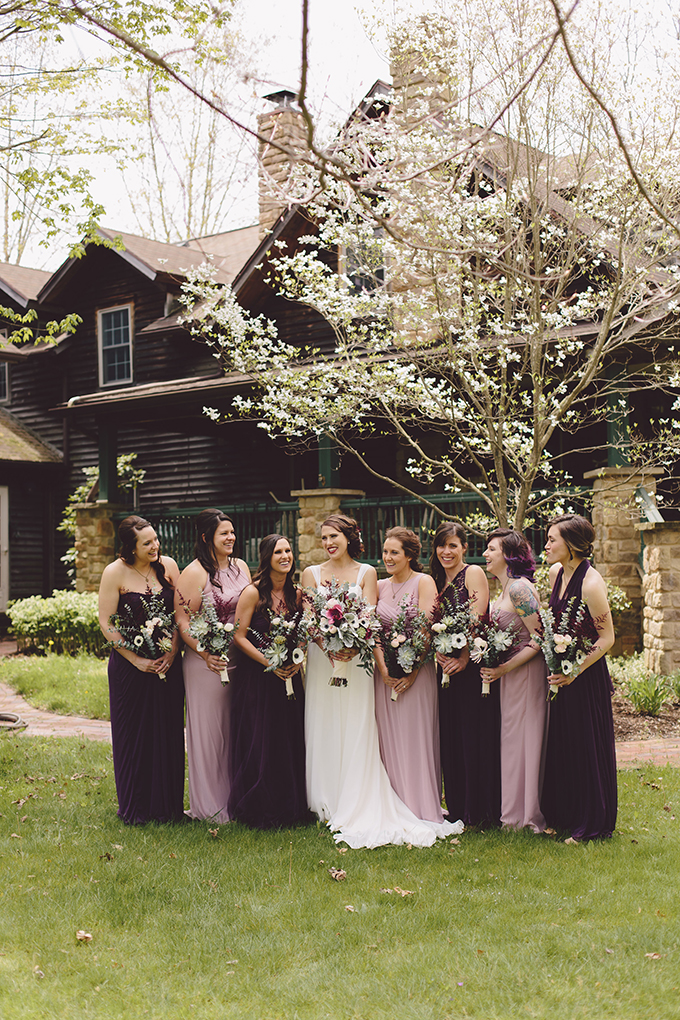 The bridesmaids were rocking lavender and purple maxi dresses and dark bouquets