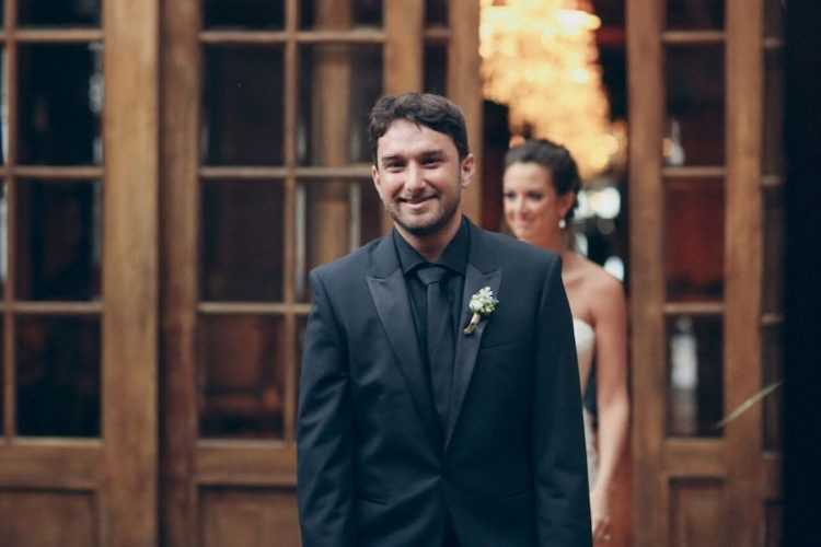 The groom was dressed in all black with a white boutonniere