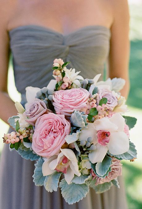 dark grey bridesmaid's dress with a pink bouquet