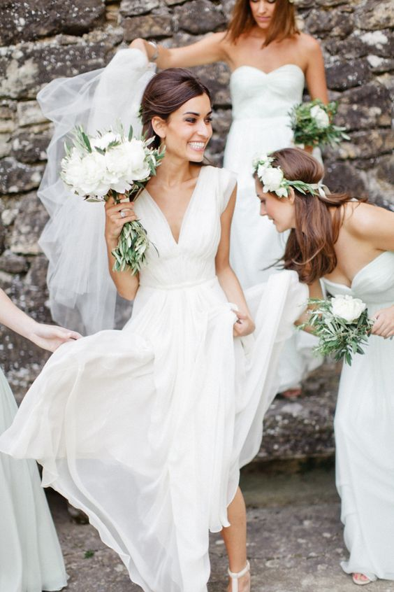 flowy white wedding dress with a V-neckline