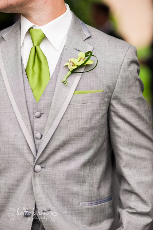 light grey suit with greenery touches