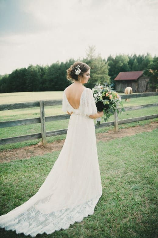 Low Back Lace Wedding Dress With A Train
