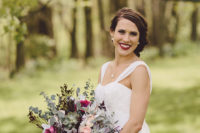 04 The bride's moody makeup and vintage side updo with a headpiece