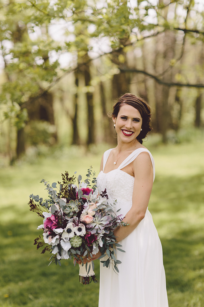 The bride's moody makeup and vintage side updo with a headpiece