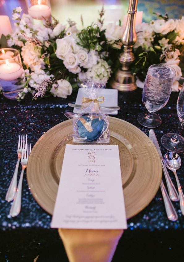 The decor was done in navy and white, with gold tableware and cutlery