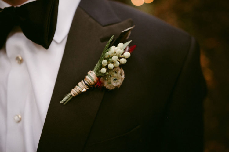 The groom wore a navy,  burgundy feather bow tie from Feather Game Birds UK