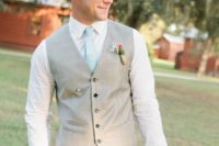 04 light grey suit with a vest and a mint tie