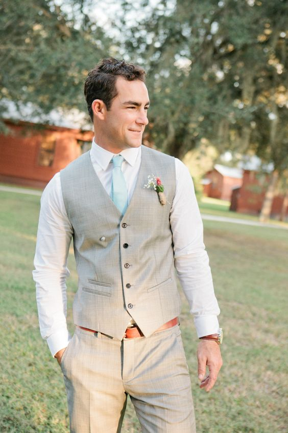 light grey suit with a vest and a mint tie
