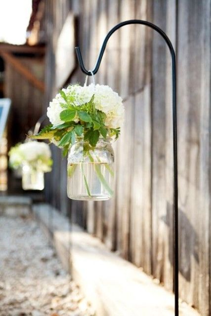 line the walkway with flowers in mason jars