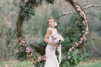 04 oversized greenery and flower wreath as a wedding backdrop