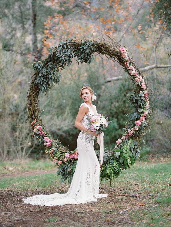 oversized greenery and flower wreath as a wedding backdrop