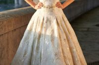 04 sleeveless V-neck ball gown with gold appliques and a belt
