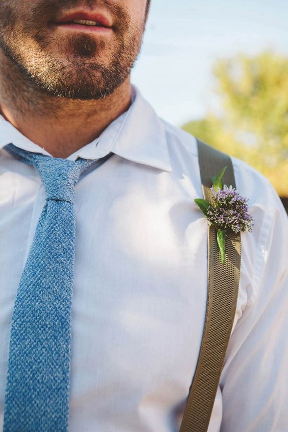 white shirt, suspenders and a tweed blue tie