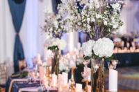 05 Navy sequin tablecloths, candles and white florals look very elegant
