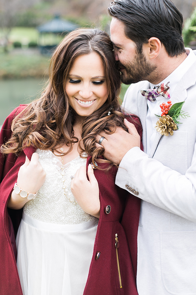 The bridal V-neck beaded dress was complemented with a burgundy coat