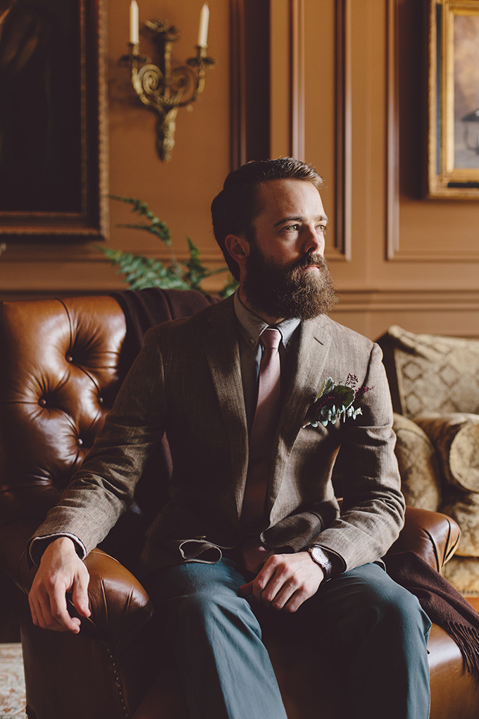 The groom was rocking a tweed jacket, a tie and blue pants, and a cool beard