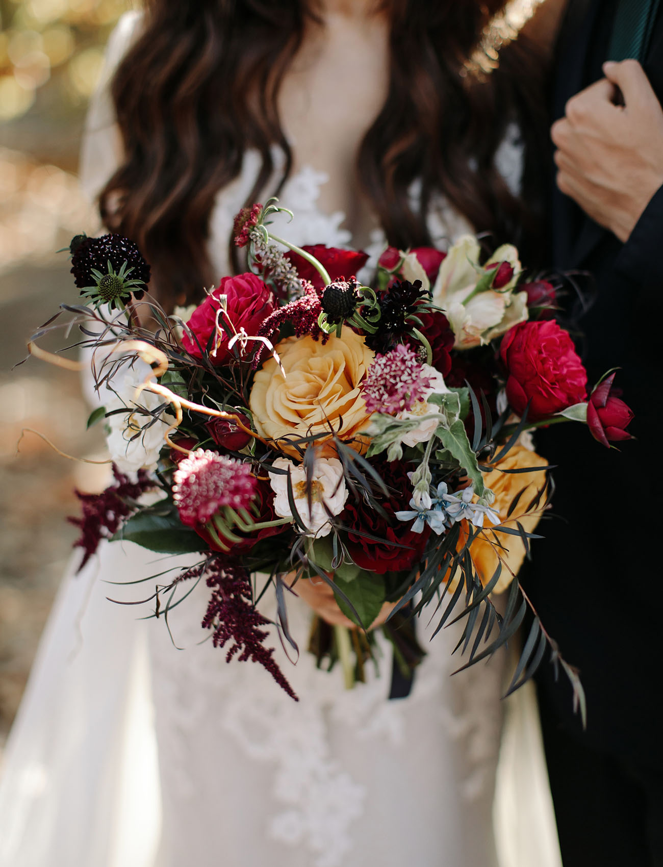 The moody bridal bouquet looked very fall like and fantasy inspired