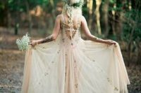 05 ethereal wedding dress in blush with floral patterns and a greenery crown