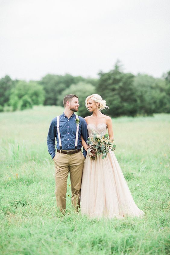 groom in tan pants, chambray shirt and suspenders
