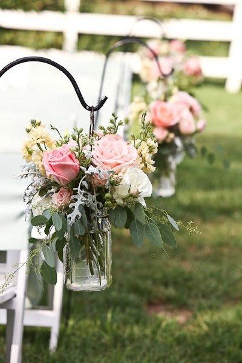 line the aisle with jars with pink flowers for a fresh spring look