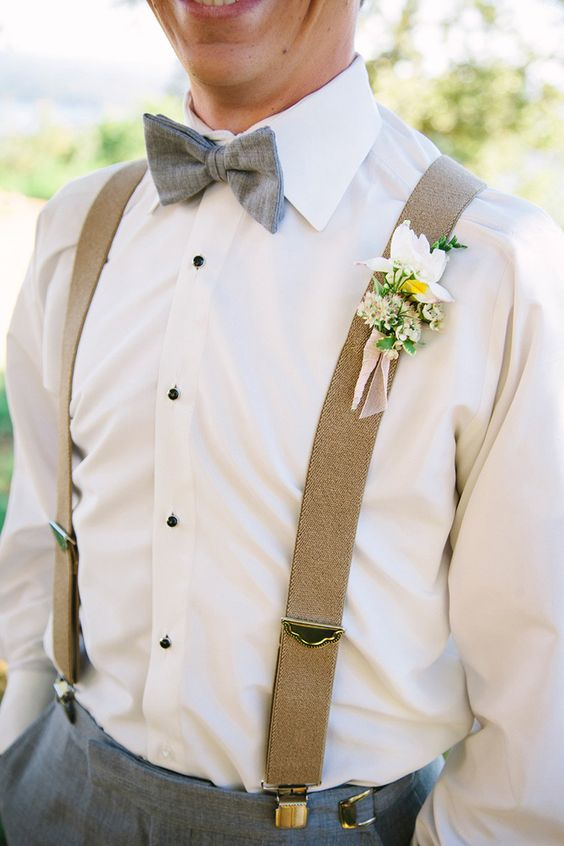 suspenders, a gret bow tie and a shirt with black buttons