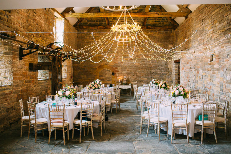 A fairy light canopy is all that a barn needed to look gorgeous