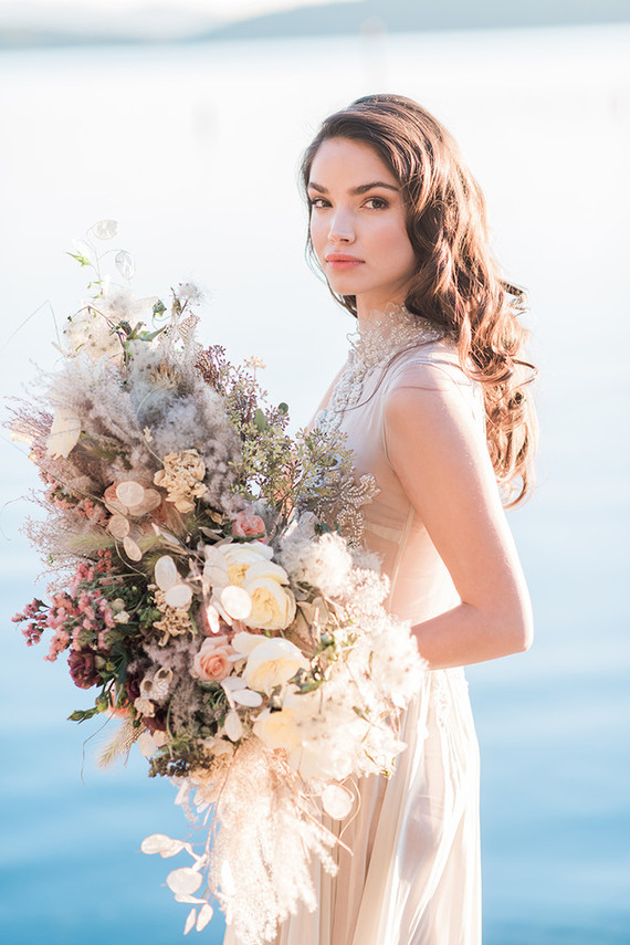 The bouquet was messy, textural and sea foam inspired