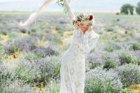 06 lace wedding dress with long sleeves, a floral crown and a messy bouquet