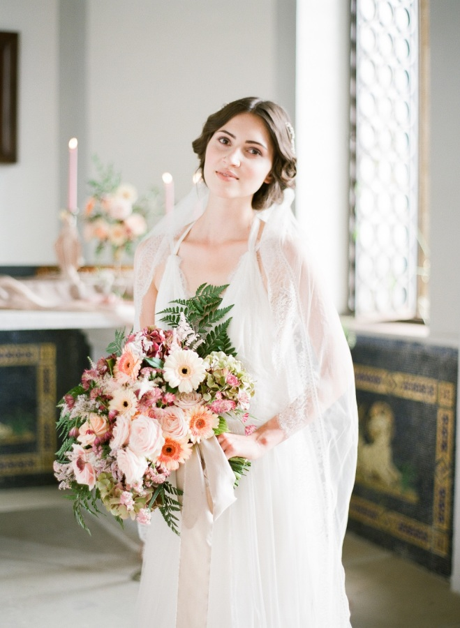 The bridal bouquet corresponded the chosen color combo of neutrals and pastels