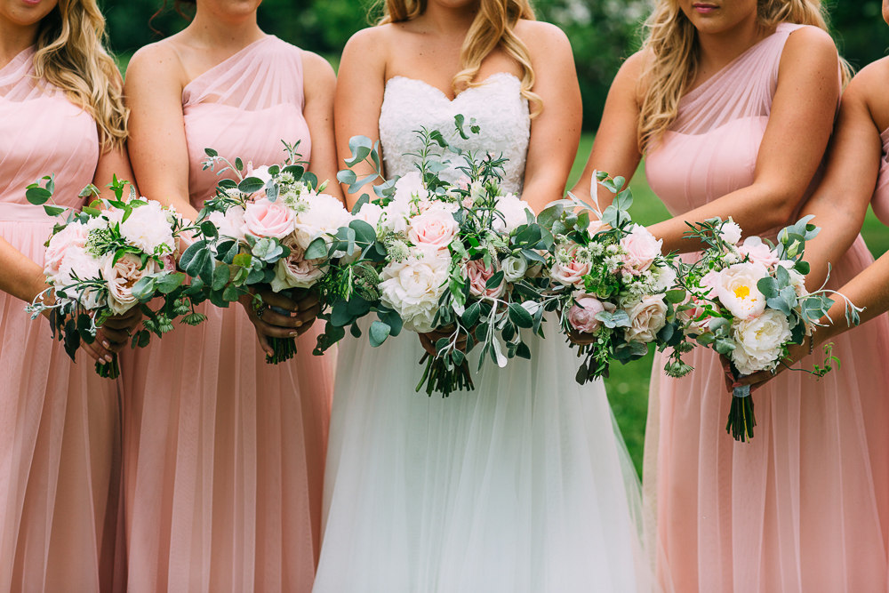 The bridesmaids were rocking blush sweetheart dresses